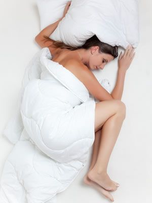 Op je zij slapen is dus gezond.